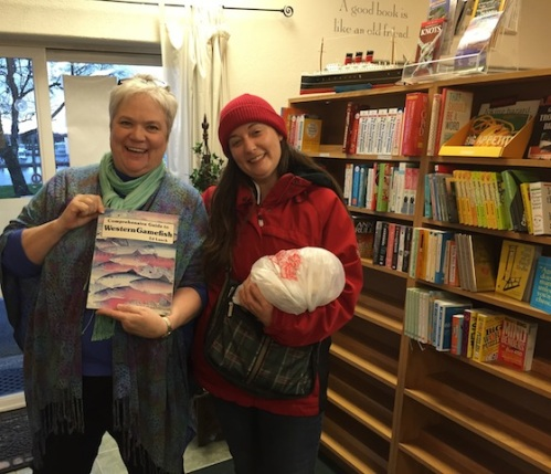 a book making new friends: Karla and Ann and one of Frank Amato's books